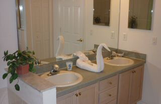 bathroom with tub, twin sinks and walk in shower